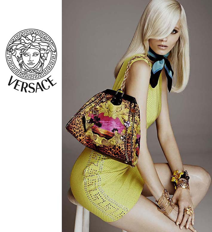 f6e798beb423 Darling model Abbey Lee Kershaw drapes this Versace for H M Ladies No. 39  handbag across her dainty shoulder while wearing Versace Yellow Studded  Silk dress ...