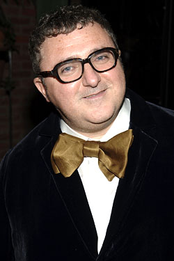 Alber Elbaz in a black jacket with gold bow tie