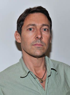 Gregory Parkinson headshot in a green shirt